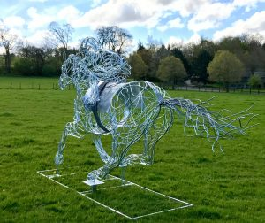 Horse and Jokey Sculpture In Wooded Area
