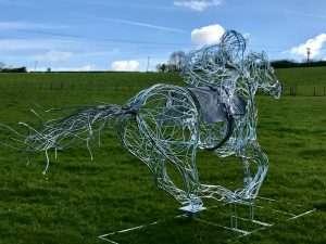 Horse and Jokey Sculpture Design In A Park