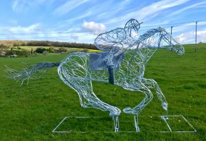 Horse and Jokey Riding Sculpture On A Sunny Day