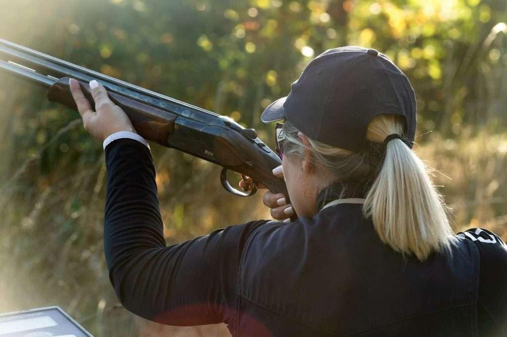 Women holding a shotgun