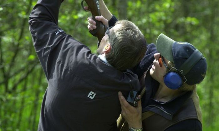 Image of two people shooting