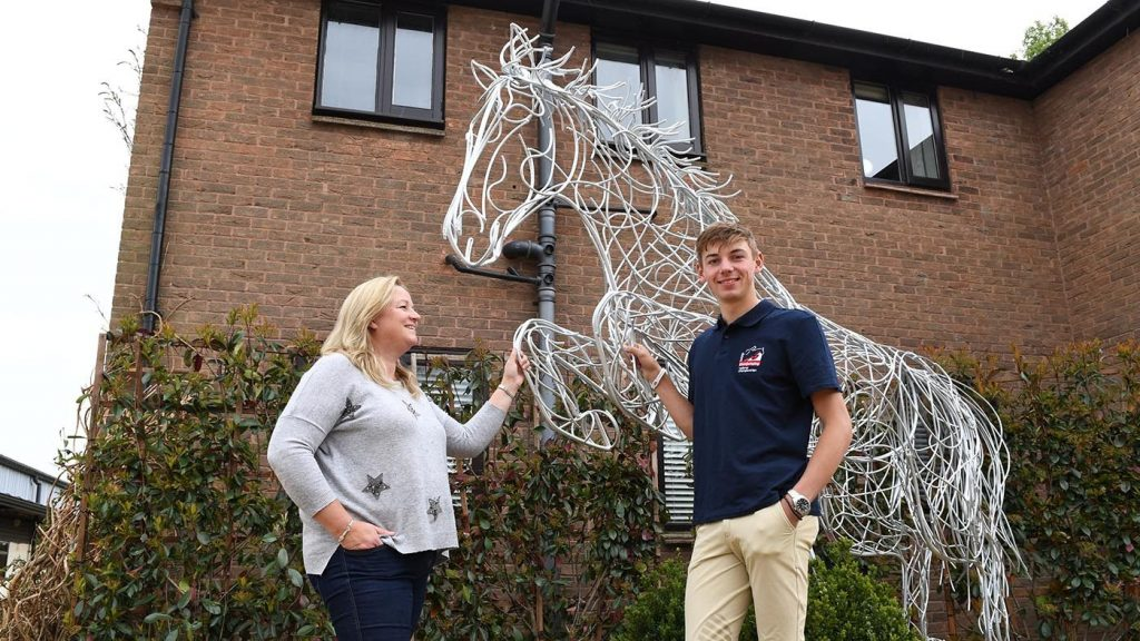 Standing Horse With Two People Next To It