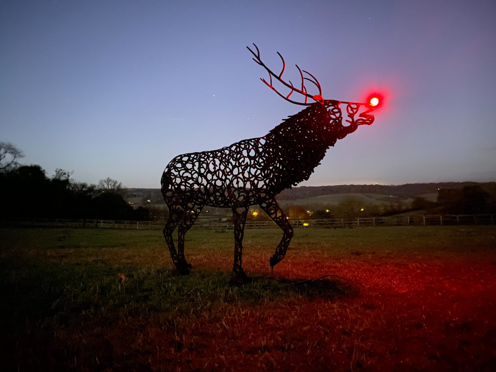 Bellowing Stag Sculpture With Red Light