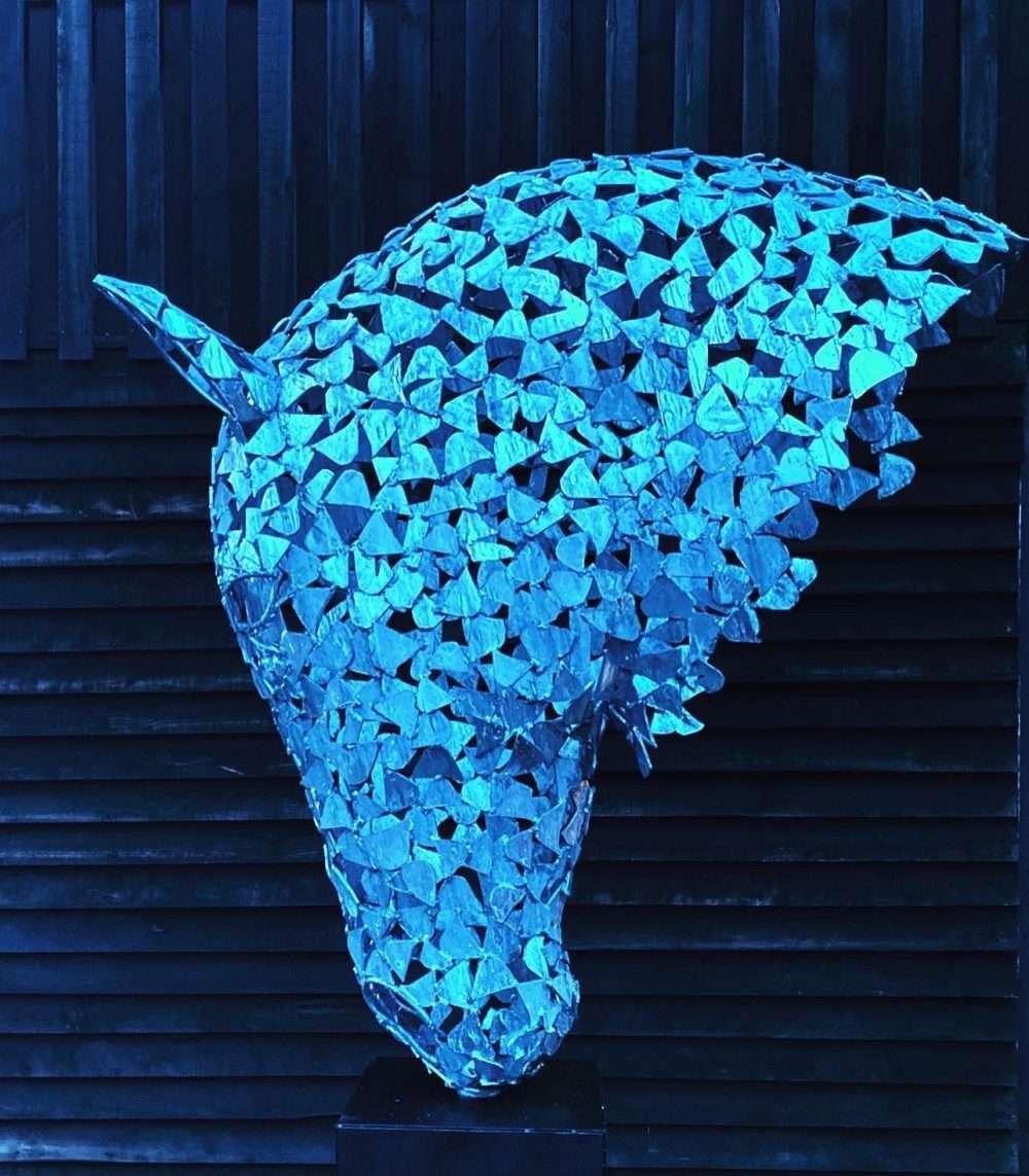 Silver Horse Head In Dark Lighting