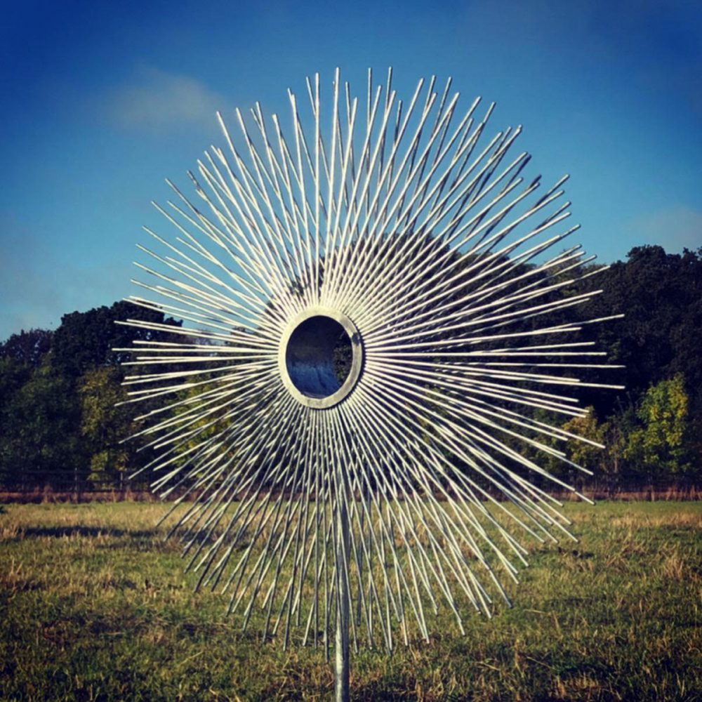 Circle Peacock Sculpture In A Field