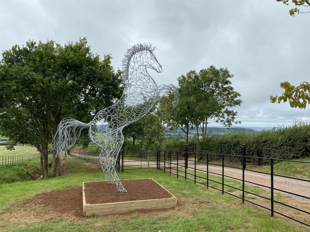 Standing Horse On Wooden Plinth