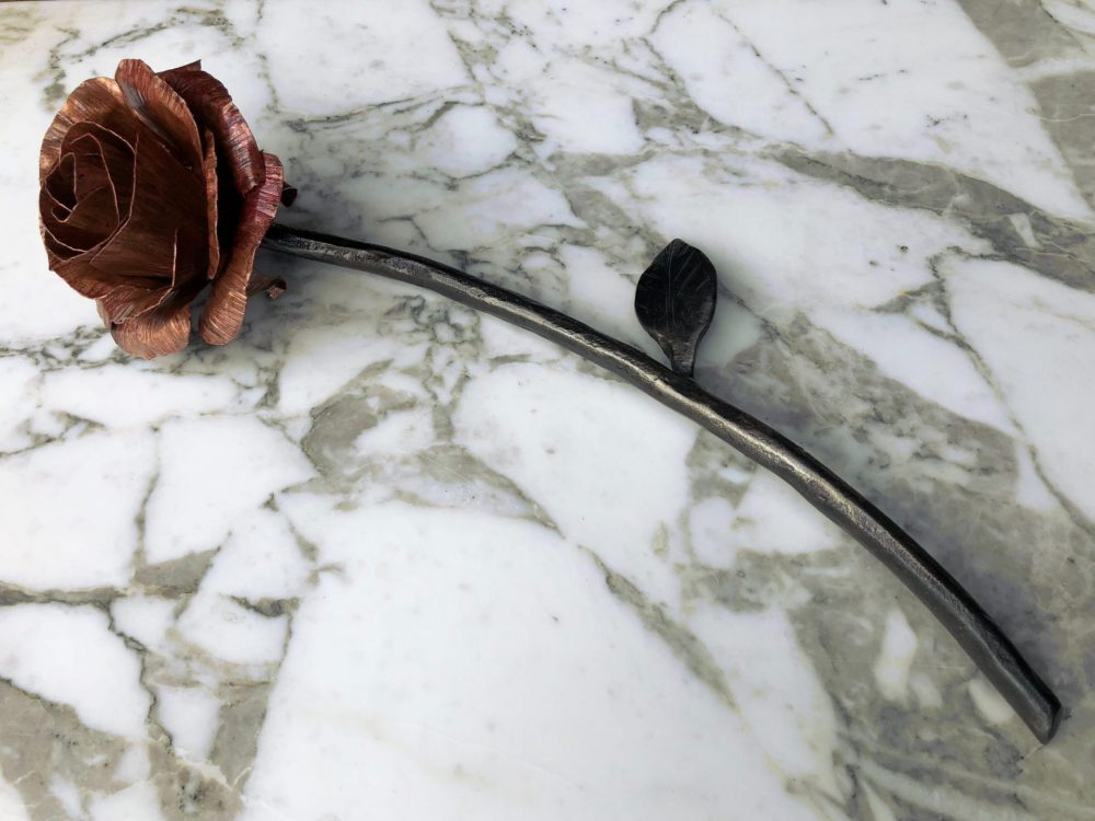 Metal Rose Flower on Marble Table
