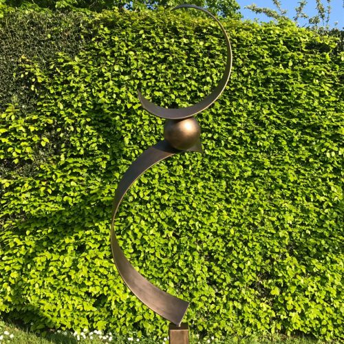 Abstract Brass Spiral Structure On A Sunny Day